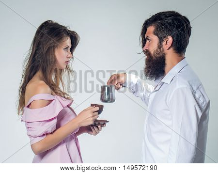 Young Couple With Coffee Cup And Pot