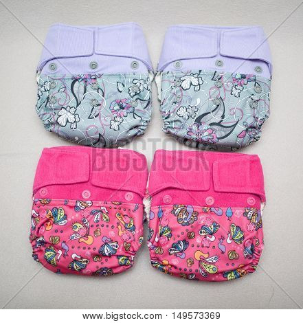 A lot of eco cloth diapers in the basket