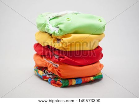 Stack Of Cloth Diapers Different Colors