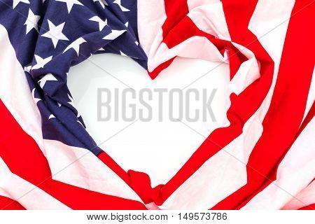 Heart shape American flag on white background .