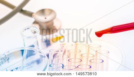 laboratory test tubes,medical glassware , Stethoscope,plastic syringe  ( Filtered image processed colorful effect. )