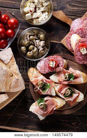 Spanish Tapas With Slices Jamon Serrano, Salami, Olives And Chee