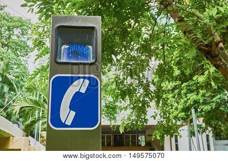 telephone sign and siren on the stainless pole for emergency.