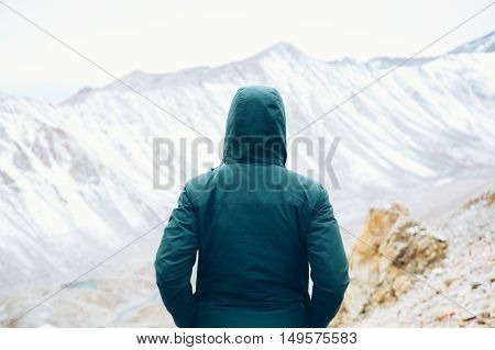 Determined Traveler With Hands In Pocket Standing And Watching Snow Mountain Scene - Solitude And Fr