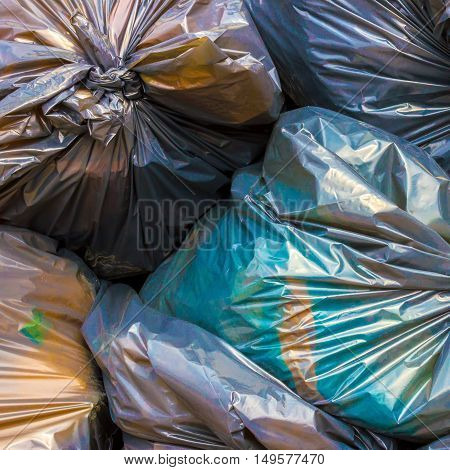Pile of garbage and waiste in colorfull bags