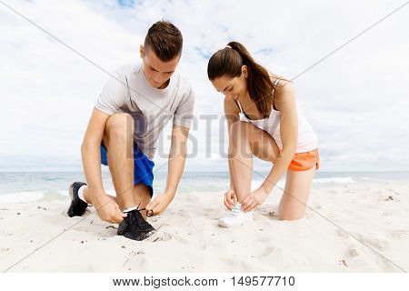 Runners lace their shoes and prepare to jogging