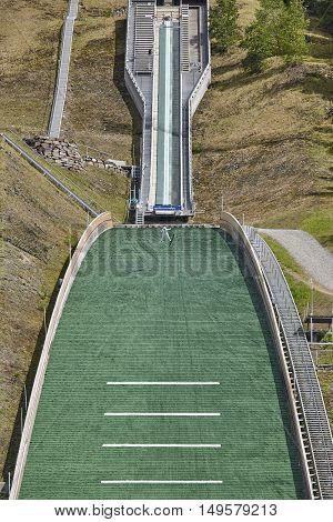 Ski jump. Artificial track. Winter sport. Norwegian summer. Vertical