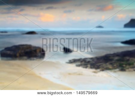 Early morning view of the beach at Polzeath Cornwall Out of focus.