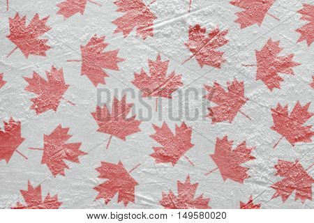 Maple leaves painted on the ice hockey rink. Concept background