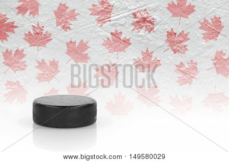 Hockey puck and maple leaves on the ice. Concept background