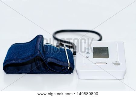 Automatic digital blood pressure monitoring meter on white background