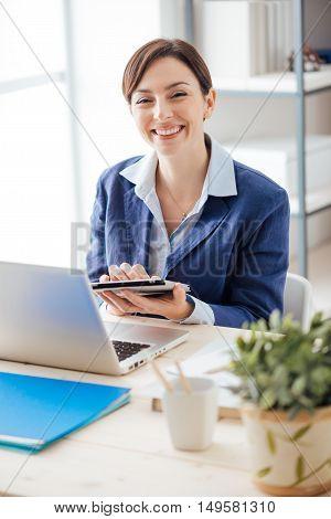 Confident Executive Using A Tablet