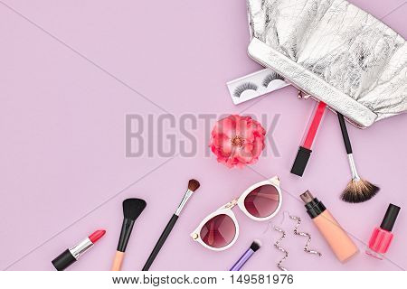 Fashion Cosmetic Makeup. Woman Beauty Accessories Set. Essentials. Fashion Design. Lipstick Brushes Eyeshadow, fashion Glamor Clutch, Stylish Watches, Rose. Minimal Concept. Top view.Cosmetic Overhead