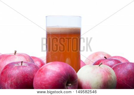 freshly squeezed Apple juice in a glass and red apples isolated