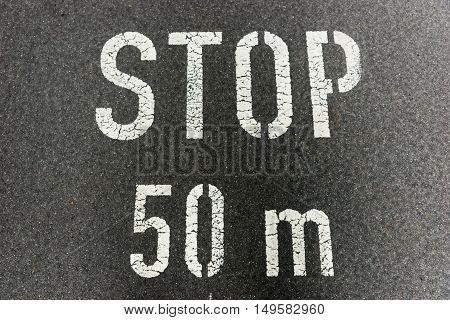 Stop 50 meters on city asphalt on floor