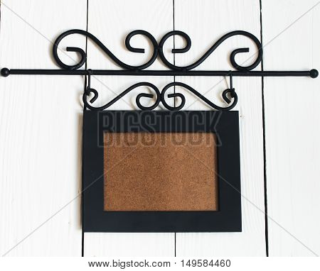 Beautiful black hanging photo frameplace for text on white background