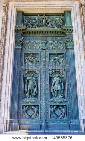 The bronze gate of St Isaac's Cathedral richly decorated with reliefs and sculptures St Petersburg Russia.