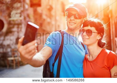 couple tourists  walking in the old town
