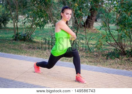Young Fitness Girl Does Lunge Exercises During Workout