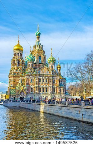SAINT PETERSBURG RUSSIA - APRIL 25 2015: The Church of the Savior on Spilled Blood with its onion domes colorful tiles bright patterns and mosaic icons is the perfect example of the medieval Russian architecture on April 25 in Saint Petersburg.