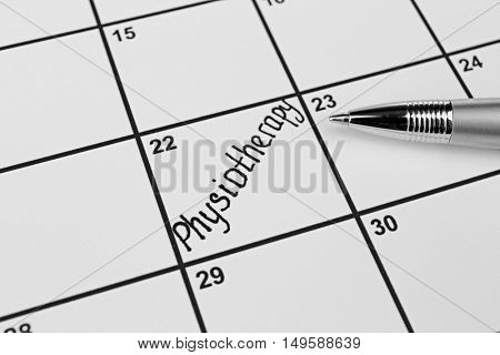 The word PHYSIOTHERAPY written on calendar planner