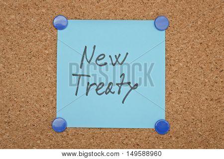 Text New Treaty written on a sticker pinned on a cork board