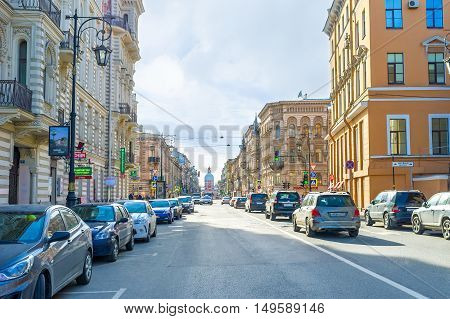 SAINT PETERSBURG RUSSIA - APRIL 25 2015: The tall splendid buildings in Pestel street with the Great Martyr and Healer St. Panteleimon Church on background on April 25 in Saint Petersburg.
