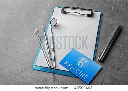 Health care concept. Visiting card and medical equipment on grey background