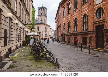 September, 22th, 2015 - Latin Quarter in Copenhagen, Denmark. Old scandinavian houses, restaurants, parked bicycles and university building.