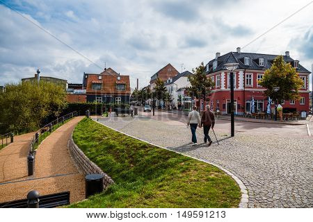 September, 23th, 2015 - pedestrian street in Hillerod, Denmark. Old scandinavian houses, restaurants and narrow street of cobblestones near Frederiksborg castle.