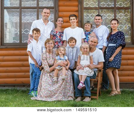 Portrait Of Big Nice Happy Family On Background Of Wooden House