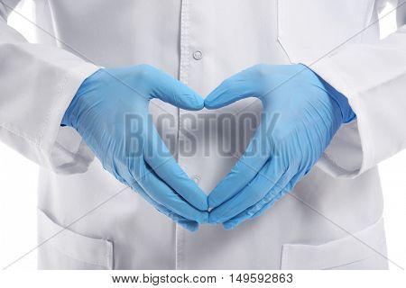 Male doctor hands in heart shape, closeup