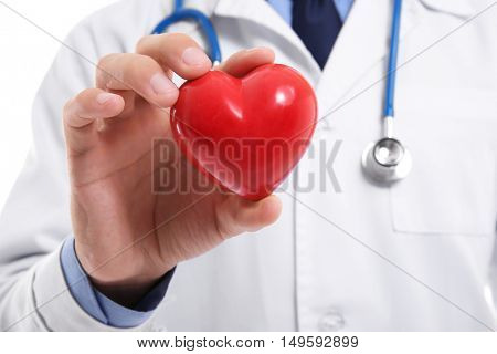 Male doctor holding red heart in hand, closeup