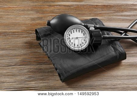 Medical manometer on a wooden background