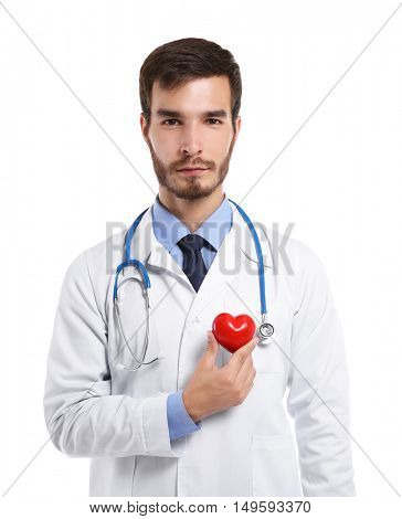 Handsome male doctor holding red heart on white background