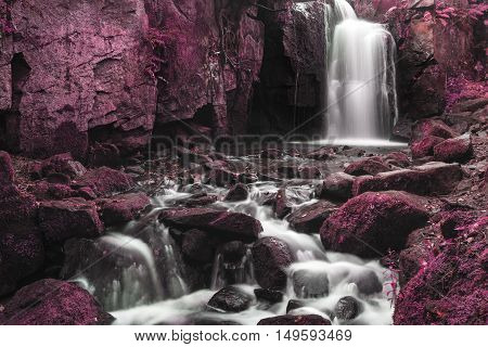 Beautiful Waterfall In Concept Forest Landscape Long Exposure Flowing Through Trees And Over Rocks