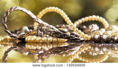 Old necklaces closeup - vintage banner background