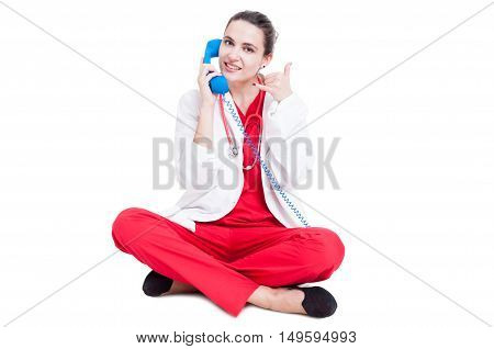 Happy Woman Doctor Speaking On Blue Receiver