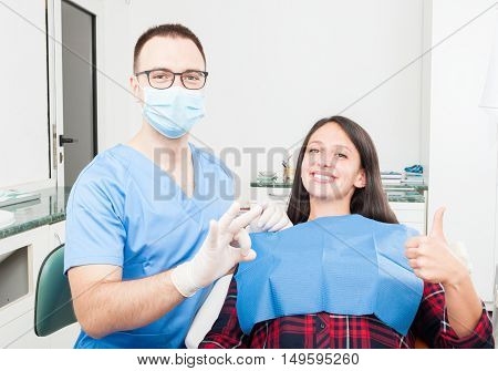 Patient And Dentist Showing Thumb Up And Okay
