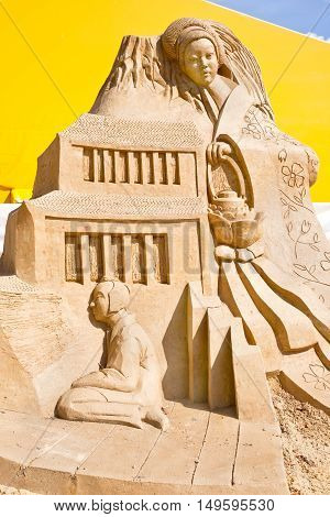 MOSCOW RUSSIA - August 18.2013: Exhibition of sculptures made of sand in Kolomenskoye city park. Sculpture Peony lantern