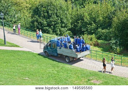 MOSCOW RUSSIA - August 18.2013: Kolomenskoye Park. Brigade gastarbeiter in the truck driven to the place of work