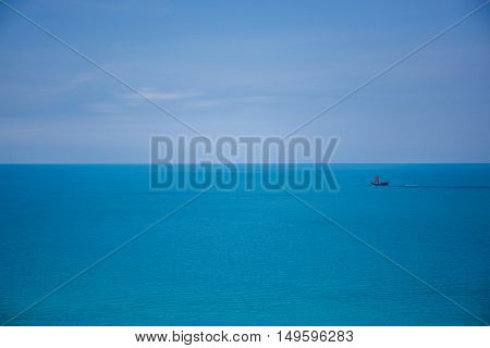 The lonely boat in crystal clear ocean