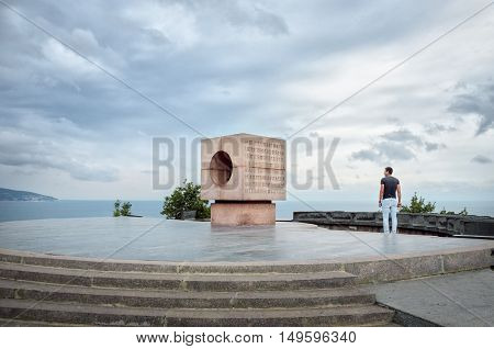 NOVOROSSIYSK, RUSSIA - AUGUST 14, 2016: Man looks at the Monument to the Sailors of the Revolution.