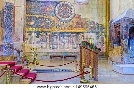 MTSKHETA GEORGIA - JUNE 6 2016: The interior of Svetitskhoveli Cathedral with restored fresco on the wall on June 6 in Mtskheta.