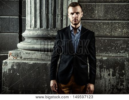 Respectable well-dressed man on a city street. Old town. Fashion shot. Business man outdoor.