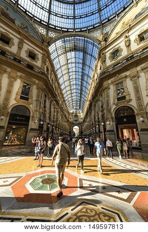 MILAN ITALY - AUGUST 29 2015: Luxury Store in Galleria Vittorio Emanuele II shopping mall in Milan with Italian restaurants