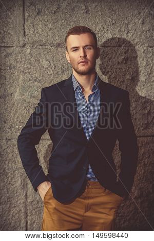 Portrait of a handsome elegant man in a suit on a city street. Fashion shot. Business man outdoor.