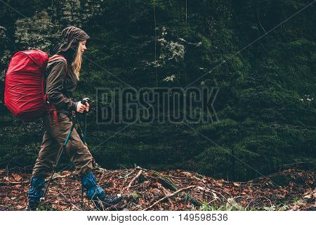 Woman Hiker with red backpack traveling Lifestyle adventure vacations concept outdoor rainy moody weather
