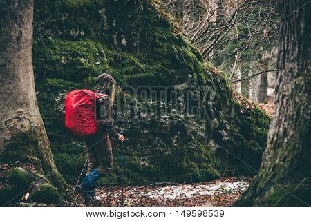 Woman Hiking in forest with red backpack Travel Lifestyle adventure vacations concept outdoor rainy moody weather