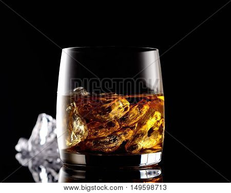 whiskey and ice on a black background